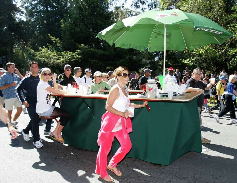 A traveling wine bar with customers rolls down Fell Street near Golden Gate Park during the 97th annual on May 18, 2008. Photo: Michael Maloney, The Chronicle / SFC