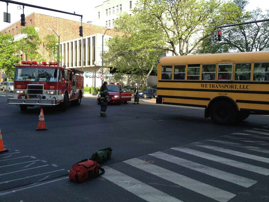 A car collided with a school bus at the interesection of Lafayette Boulevard and State Street on Friday morning. There were no apparent injuries. Photo: Frank Juliano / Connecticut Post