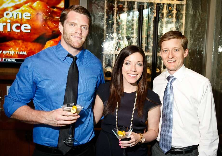 Todd Borland, left, Katie Borland, center, and Jason Klein attend the March of Dimes Kickoff event , Tuesday, May 14, 2013, in Del Frisco's Grille in Houston. ( Nick de la Torre / Chronicle )