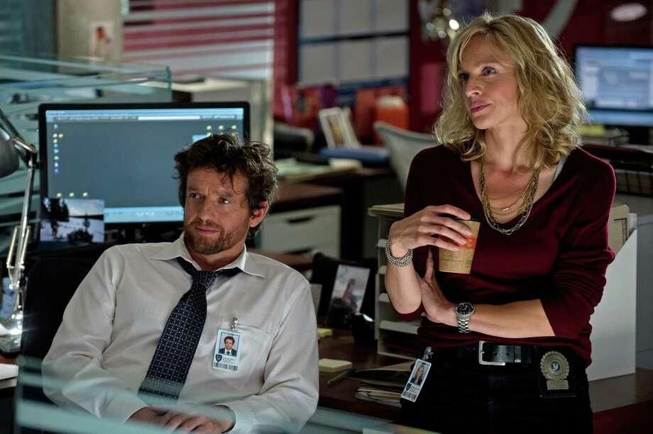 "Detectives Oscar Vega (Louis Ferreira) and Angie Flynn (Kristin Lehman) investigate murders in the new ABC drama ""Motive."" Photo: Carole Segal, Handout / ONLINE_YES"