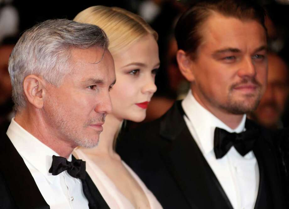 From left, director Baz Luhrmann, actors Carey Mulligan and Leonardo Di Caprio arrive for the opening ceremony and the screening of The Great Gatsby at the 66th international film festival, in Cannes, southern France, Wednesday, May 15, 2013. (Photo by Joel Ryan/Invision/AP) Photo: Joel Ryan, INVL / Invision