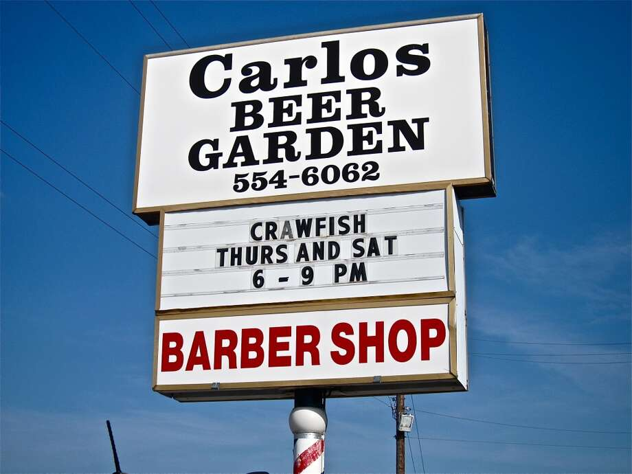 The sign for Carlos Beer Garden and Barber Shop in Webster.