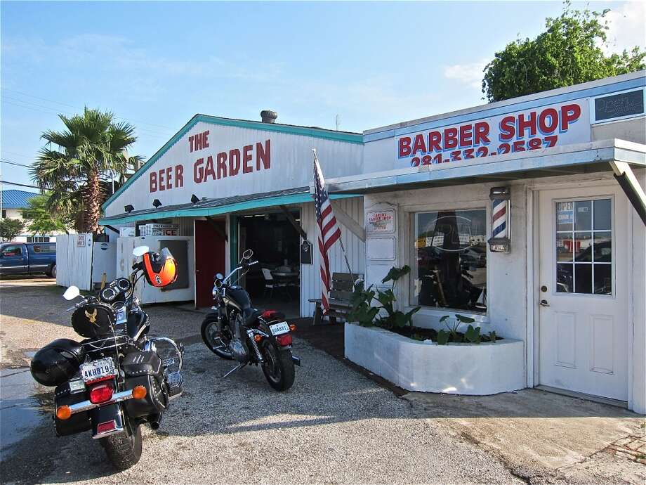 Front view of Carlos' Beer Garden and Barber Shop on Hwy 3 in Webster.