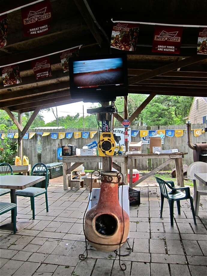 Under the covered outdoor dining terrace at Carlos Beer Garden.