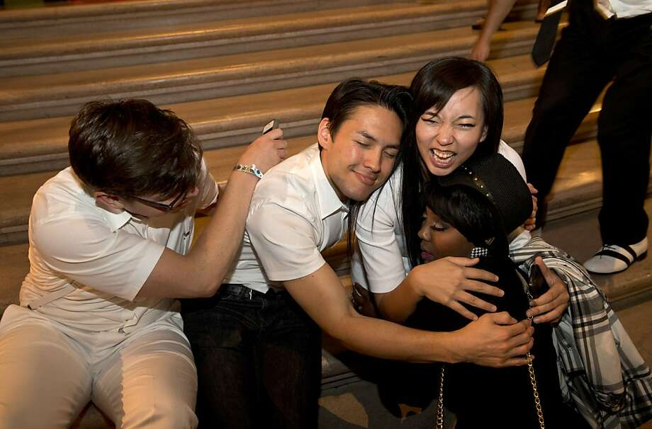 Alex Page, Glen McDaniel, Grace Shim and Rae RenŽ (left to right), all members of JJanelle Monáe's band, relax on the steps of City Hall at the end of the after party for the San Francisco Symphony's inaugural Spring Gala in San Francisco, Calif., on Thursday, May 16, 2013. Photo: Laura Morton, Special To The Chronicle