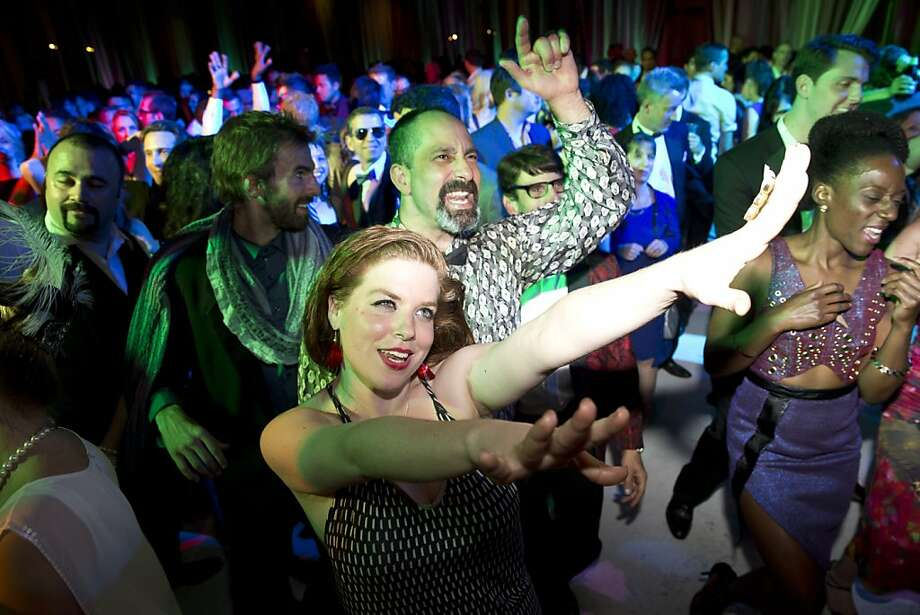 Elizabeth Castaneda dances to the music of the Michael Jackson tribute band Foreverland during the after party for the San Francisco Symphony's inaugural Spring Gala at City Hall in San Francisco, Calif., on Thursday, May 16, 2013. Photo: Laura Morton, Special To The Chronicle