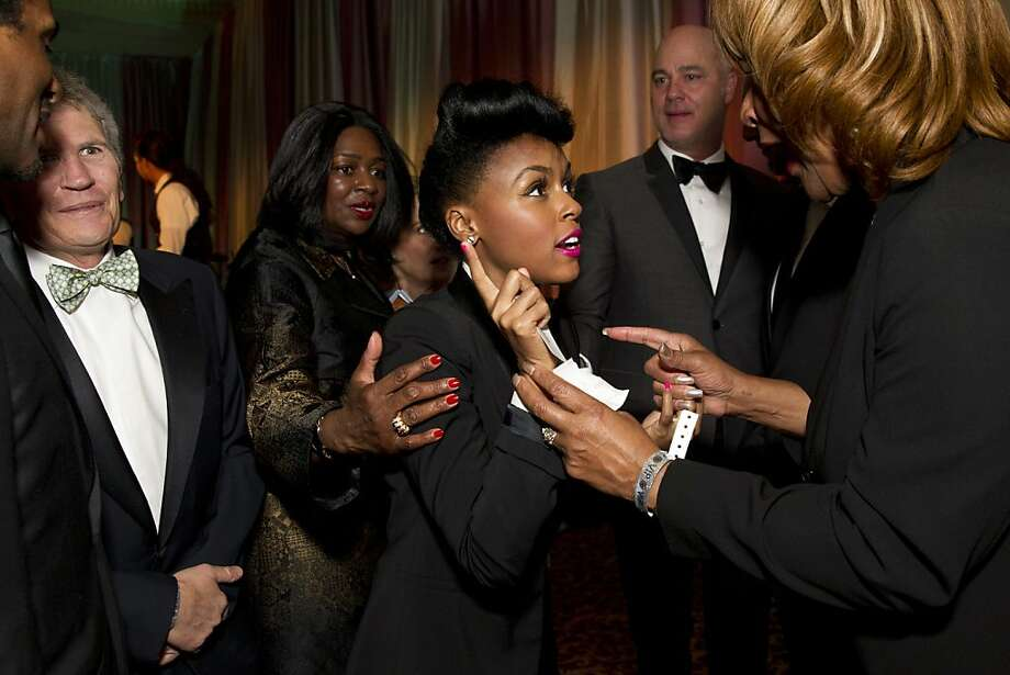 Janelle Monáe (center) talks with fans during the VIP after party for the San Francisco Symphony's inaugural Spring Gala at City Hall in San Francisco, Calif., on Thursday, May 16, 2013. Monáe and her band performed with the symphony that evening. Photo: Laura Morton, Special To The Chronicle