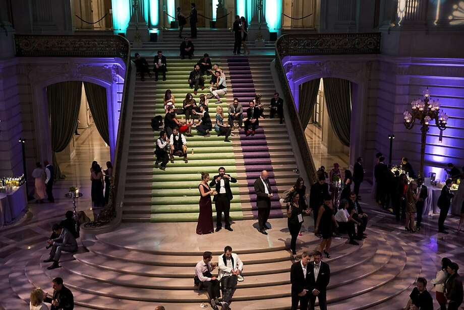 Guests of the after party for the San Francisco Symphony's inaugural Spring Gala relax on the stairs of City Hall during the party in San Francisco, Calif., on Thursday, May 16, 2013.  The gala raised funds for the symphony's education programs. Photo: Laura Morton, Special To The Chronicle