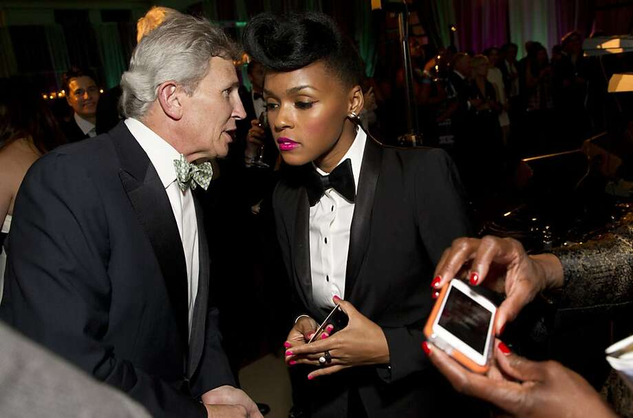 Janelle Monáe talks with Doug Goldman (left) during the VIP after party for the San Francisco Symphony's inaugural Spring Gala at City Hall in San Francisco, Calif., on Thursday, May 16, 2013. Monáe and her band performed with the symphony that evening. Photo: Laura Morton, Special To The Chronicle