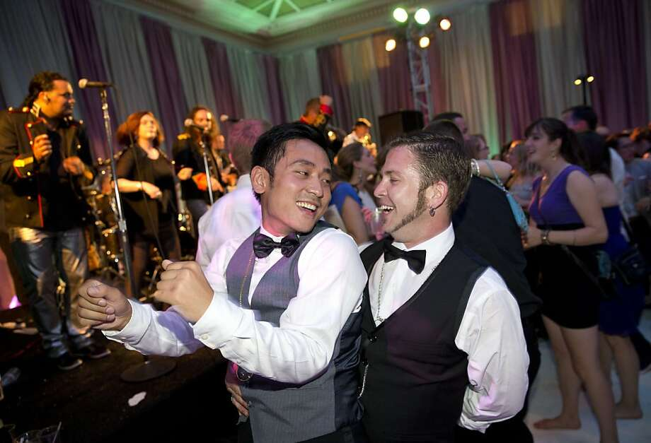 Khoi Nguyen (left) dances with Ralph Hoy during the after party for the San Francisco Symphony's inaugural Spring Gala at City Hall in San Francisco, Calif., on Thursday, May 16, 2013. Photo: Laura Morton, Special To The Chronicle