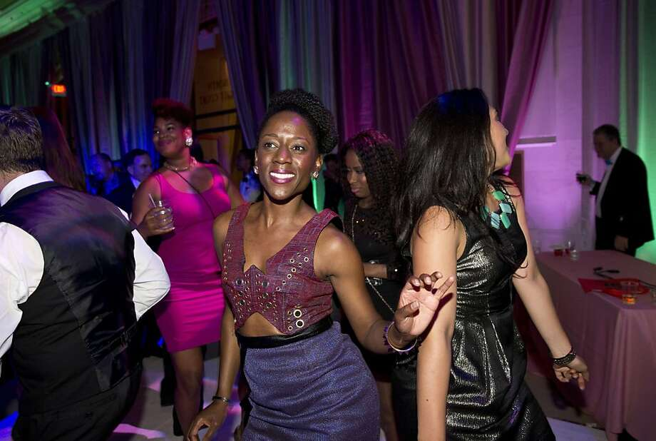 Temi Ogunyoku (center) enjoys the dance floor during the after party for the San Francisco Symphony's inaugural Spring Gala at City Hall in San Francisco, Calif., on Thursday, May 16, 2013. Photo: Laura Morton, Special To The Chronicle