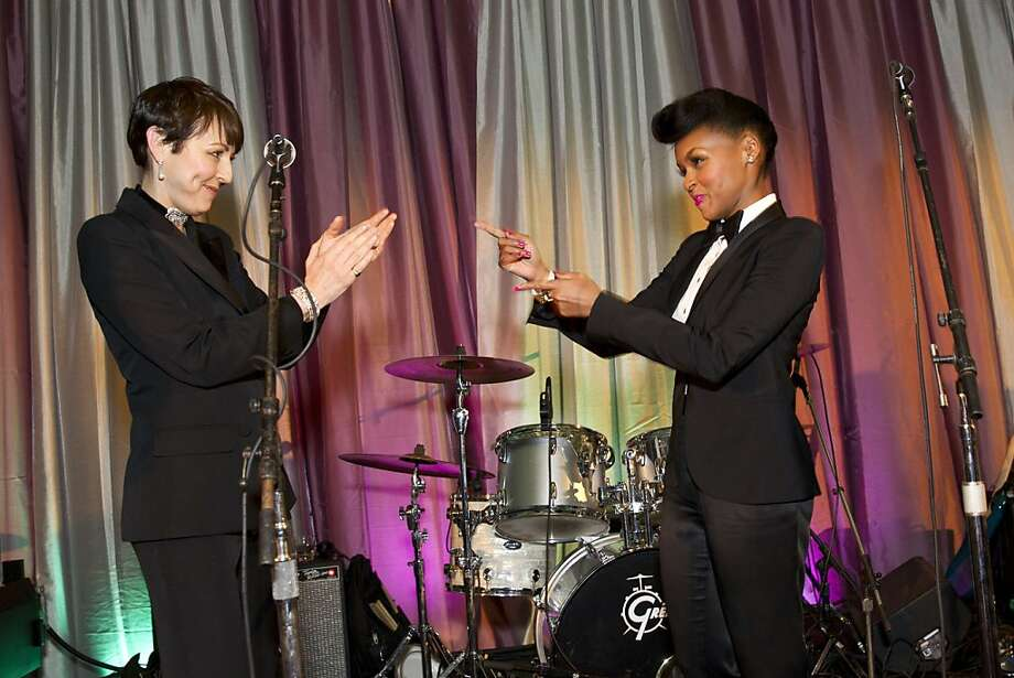 San Francisco Symphony President Sako Fisher (left) welcomes musician Janelle Monáe onstage during the VIP after party for the San Francisco Symphony's inaugural Spring Gala at City Hall in San Francisco, Calif., on Thursday, May 16, 2013.  Photo: Laura Morton, Special To The Chronicle