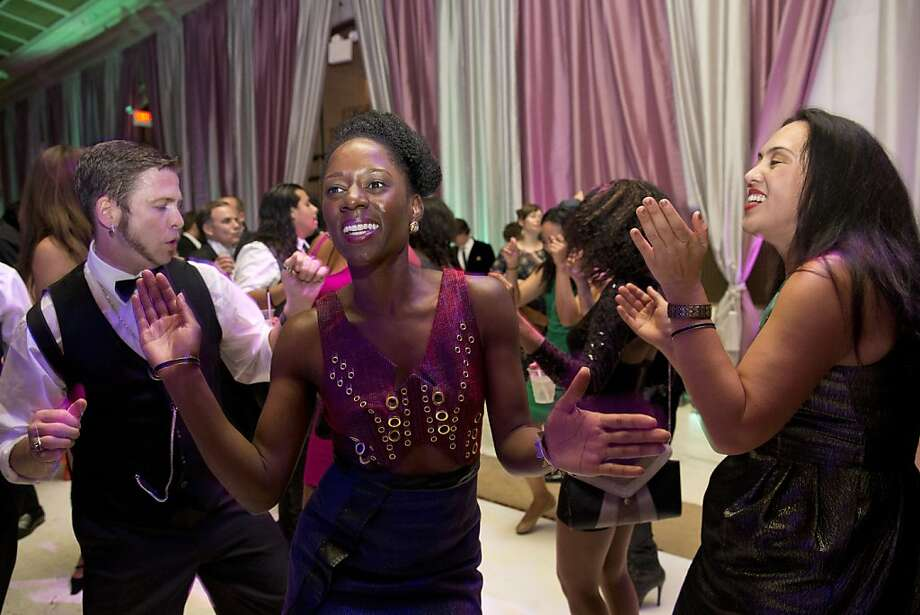 Ralph Hoy, Temi Ogunyoku and Jessica Fyles (left to right) enjoy the dance floor during the after party for the San Francisco Symphony's inaugural Spring Gala at City Hall in San Francisco, Calif., on Thursday, May 16, 2013. Photo: Laura Morton, Special To The Chronicle