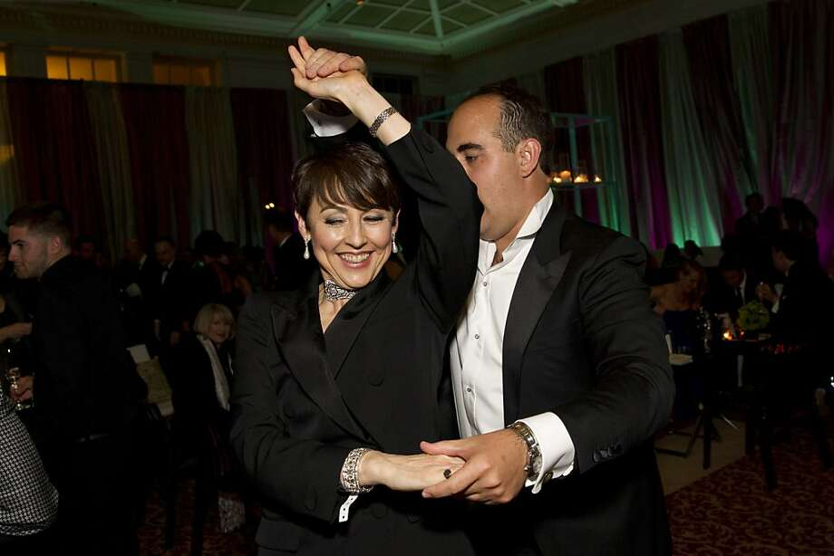 San Francisco Symphony President Sako Fisher dances with her son Sam Fisher during the VIP after party for the symphony's inaugural Spring Gala at City Hall in San Francisco, Calif., on Thursday, May 16, 2013.  The gala raised money for the symphony's education programs. Photo: Laura Morton, Special To The Chronicle