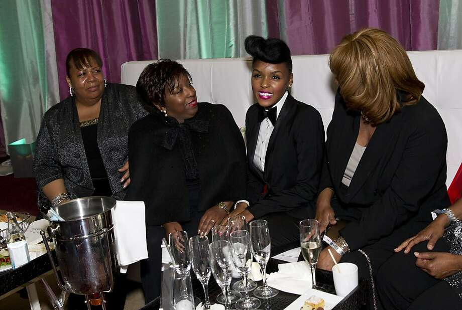 Janelle Monáe (second from right) sits down to talk with fans Janice Milburn, Liz Johnson and Marsha Henderson (left to right) during the VIP after party at the San Francisco Symphony's inaugural Spring Gala at City Hall in San Francisco, Calif., on Thursday, May 16, 2013.  Photo: Laura Morton, Special To The Chronicle