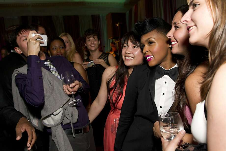 Janelle Monáe (third from right) poses for photos with fans while stopping by the VIP after party during the San Francisco Symphony's inaugural Spring Gala at City Hall in San Francisco, Calif., on Thursday, May 16, 2013.  Photo: Laura Morton, Special To The Chronicle