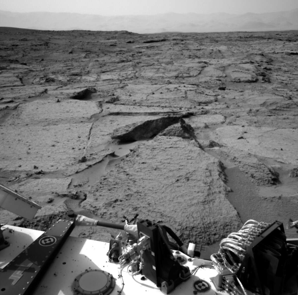 """This Dec. 12, 2012 file image provided by NASA shows the Mars rover Curiosity at a pit stop, a shallow depression called """"Yellowknife Bay."""""""