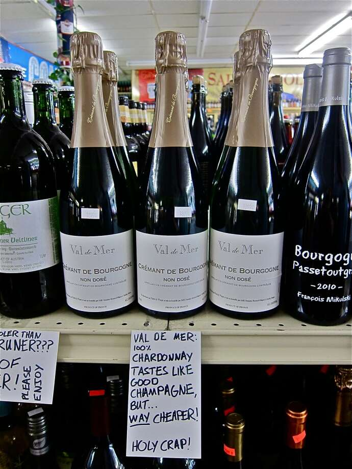 Some of Justin Vann's wine selections for D&Q Beer Station, with hand-written shelf cards.