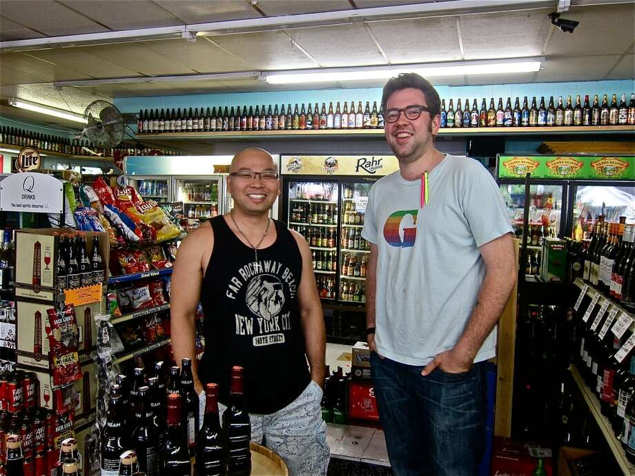 Brandon Nguyen, owner of D&Q Beer Station, with wine consultant Justin Vann.