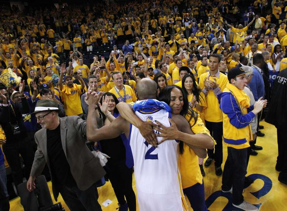 Jarrett Jack gets a hug from fan Leah Hoskins after the Warriors lost to the Spurs 94-82. The Golden State Warriors played the San Antonio Spurs in Game 6 of the Western Conference Semifinals at Oracle Arena in Oakland, Calif., on Thursday, May 16, 2013.
