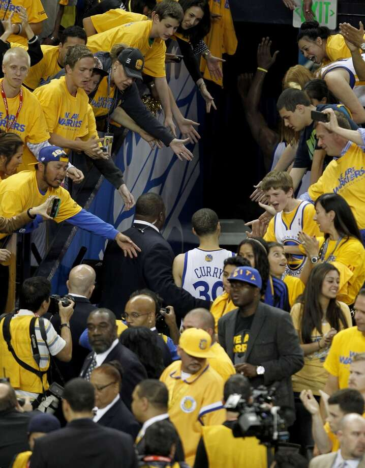 The Wariors' Stephen Curry thanks fans as he leaves the court as the Golden State Warriors lose to the the San Antonio Spurs, 94-82 in game 6 of the western conference NBA  semi-finals at Oracle Arena in Oakland, Calif.