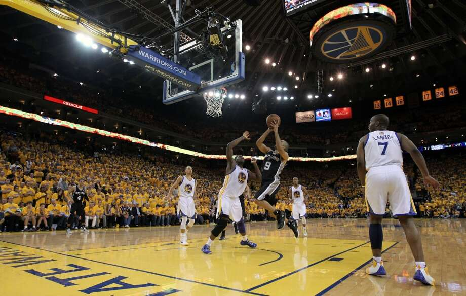 San Antonio Spurs Tony Parker scores against the Golden State Warriors in the second half of game 6 of the NBA western conference semi finals game at Oracle Arena in Oakland, Calif., on Thursday, May 16, 2013. Spurs won 94-82