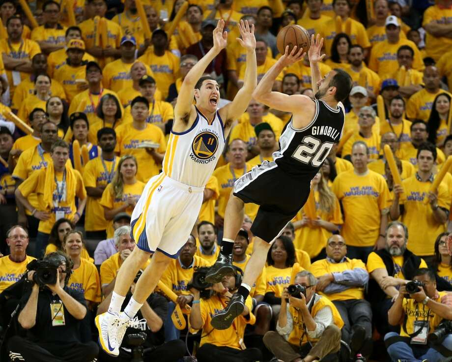 Manu Ginobli of the San Antonio Spurs shoots over Klay Thompson #11 of the Golden State Warriors in Game Six of the Western Conference Semifinals during the 2013 NBA Playoffs on May 16, 2013 at the Oracle Arena in Oakland, California. The Spurs won 94-82 to take the series 4-2.