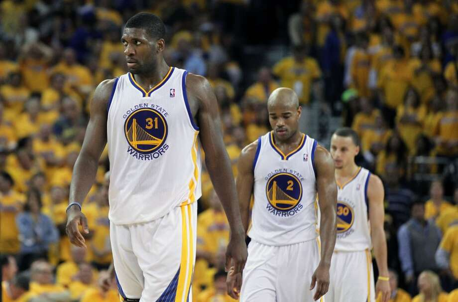 Golden State Warriors, Festus Ezeli (31) Jarrett Jack (2) and Stephen Curry (30) walk up court after a foul late into the 4th period in the second half of game 6 of the NBA western conference semi finals game with the San Antonio Spurs at Oracle Arena in Oakland, Calif., on Thursday, May 16, 2013. Spurs won 94-82