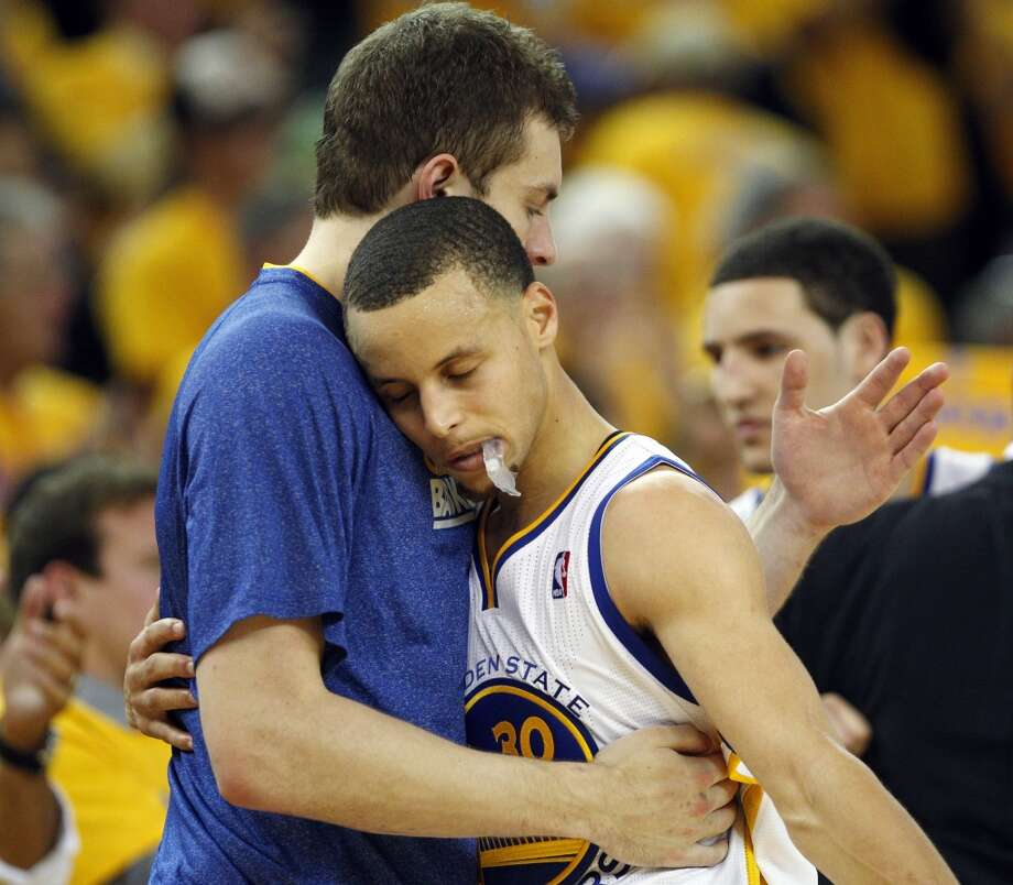 David Lee hugs Stephen Curry when he came off the court as the game was winding down with the Warriors losing to the Spurs 94-82. The Golden State Warriors played the San Antonio Spurs in Game 6 of the Western Conference Semifinals at Oracle Arena in Oakland, Calif., on Thursday, May 16, 2013.