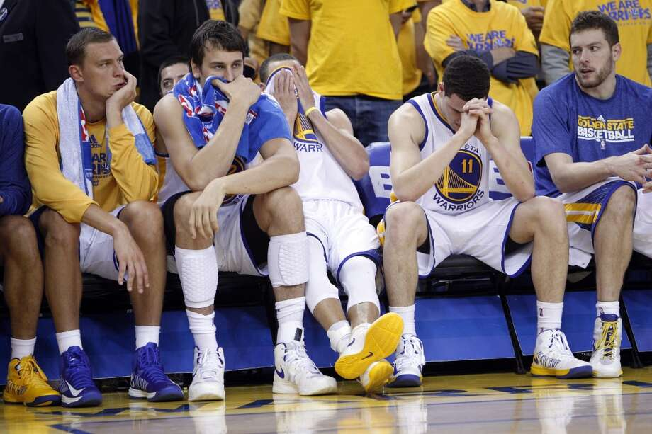 The Warriors bench shows their dejection as the game was winding down. The Golden State Warriors played the San Antonio Spurs in Game 6 of the Western Conference Semifinals at Oracle Arena in Oakland, Calif., on Thursday, May 16, 2013, losing 94-82.