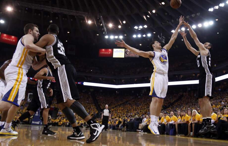 Klay Thompson (11) tries to defend against Manu Ginobli (20) in the first half. The Golden State Warriors played the San Antonio Spurs in Game 6 of the Western Conference Semifinals at Oracle Arena in Oakland, Calif., on Thursday, May 16, 2013.