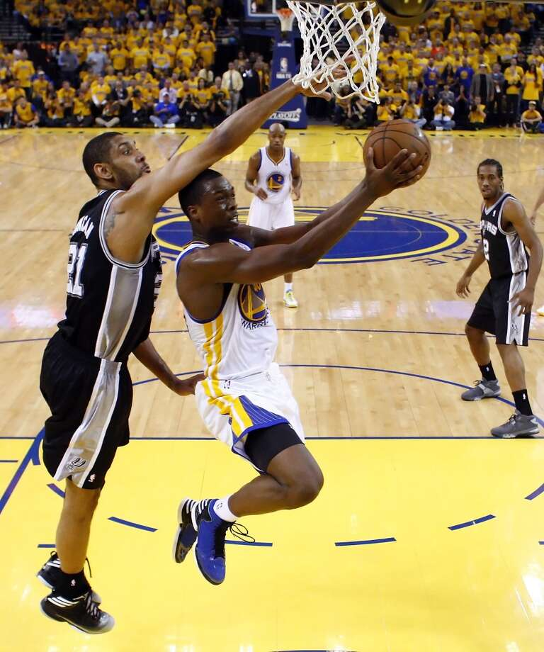 Tim Duncan (21) tries to defend against Harrison Barnes (40) in the second half.  The Golden State Warriors played the San Antonio Spurs in Game 6 of the Western Conference Semifinals at Oracle Arena in Oakland, Calif., on Thursday, May 16, 2013, losing 94-82.