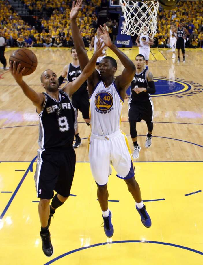 Tony Parker (9) drives under the basket defended by Harrison Barnes (40) in the second half.  The Golden State Warriors played the San Antonio Spurs in Game 6 of the Western Conference Semifinals at Oracle Arena in Oakland, Calif., on Thursday, May 16, 2013, losing 94-82.