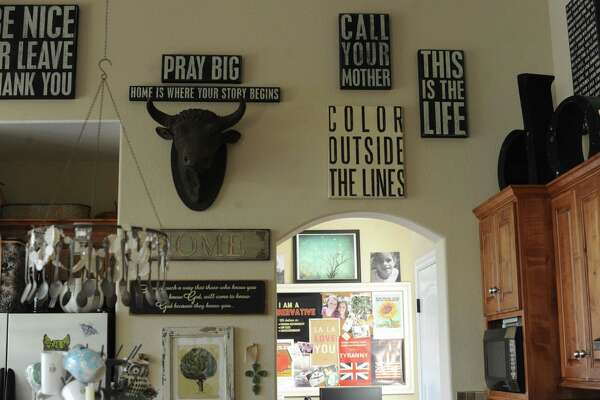 "Typography prints decorate the walls in the kitchen of Denise and Mickey Hubicsak's home in New Braunfels. ""Call Your Mother"" is everybody's favorite."