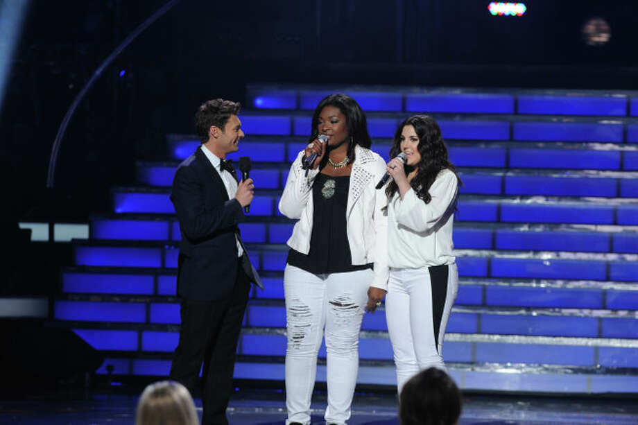 AMERICAN IDOL: Host Ryan Seacrest introduces the Season 12 Finalists Candice Glover (C) and Kree Harrison (R) during the  season 12 AMERICAN IDOL GRAND FINALE at the Nokia Theatre on Thursday. May 16, 2013 in Los Angeles, California.  CR: Ray Mickshaw/FOX