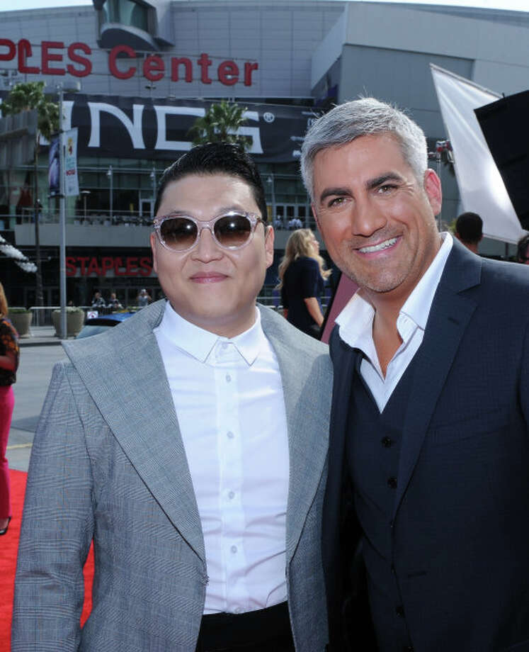 AMERICAN IDOL: AMERICAN IDOL Season Five winner Taylor Hicks and special guest Psy arrive on the red carpet for the  season 12 AMERICAN IDOL GRAND FINALE at the Nokia Theatre on Thursday. May 16, 2013 in Los Angeles, California.  CR: Ray Mickshaw/FOX