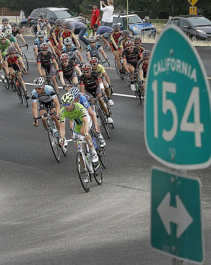 Cyclists turn onto a road from California 154 as spectators cheer them on during the fifth stage of the Tour of California cycling race, Thursday, May 16, 2013, in Los Olivos, Calif. Photo: Daniel Dreifuss, Associated Press