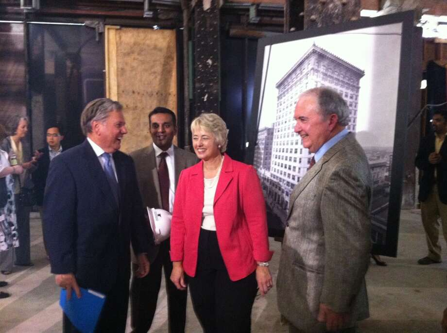 (From left to right) Developers Bill Franks and Pritesh Patel with Mayor Annise Parker and investor Lee Stafford in the lobby space of 806 Main.