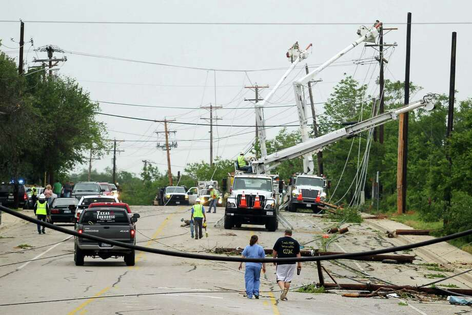 Crews work to clear power lines damaged by Wednesday's tornado in Cleburne, Texas on Thursday, May 16, 2013. Ten tornadoes touched down in several small communities in Texas overnight, leaving at least six people dead, dozens injured and hundreds homeless. Emergency responders were still searching for missing people Thursday afternoon. (AP Photo/Ron Russek II) Photo: Ron Russek II, FRE / AP