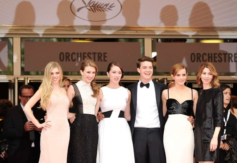 (L-R) Actresses Claire Julien, Taissa Fariga and Katie Chang, actor Israel Broussard, actress Emma Watson and director Sophia Coppola attend 'The Bling Ring' premiere during The 66th Annual Cannes Film Festival at the Palais des Festivals on May 16, 2013 in Cannes, France.