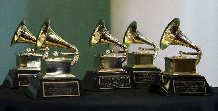Beyonce's five 2003 Grammy awards on display during program featuring her mother, Tina Knowles, at the University of Houston MD Anderson Library, Monday, Oct. 3, 2011, in Houston. Tina Knowles was featured at the University of Houston's Friends of Women's Studies Living Archives program, which honors the achievements of local women. Beyonce's debut solo album Dangerously in Love in 2003, became one of the most successful albums of that year, earning her a then record-tying five Grammy Awards.