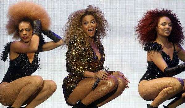Beyoncé shows off fashionable girl power while performing in England.  (Photo by Matt Cardy/Getty Images)