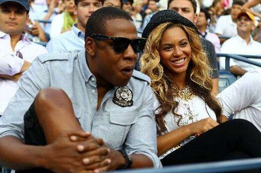 Early in their relationship, Beyoncé and rap mogul Jay-Z raised eyebrows. The couple married in 2008, in secret of course. (Getty Images)