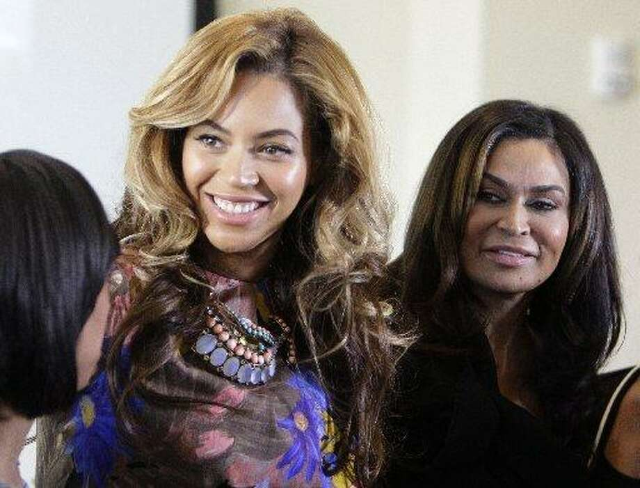 Beyonce Knowles, left, poses for photos with her mother, Tina Knowles, right, at the University of Houston MD Anderson Library, Monday, Oct. 3, 2011, in Houston. Tina Knowles was featured at the University of Houston's Friends of Women's Studies Living Archives program, which honors the achievements of local women. (Melissa Phillip / Houston Chronicle)