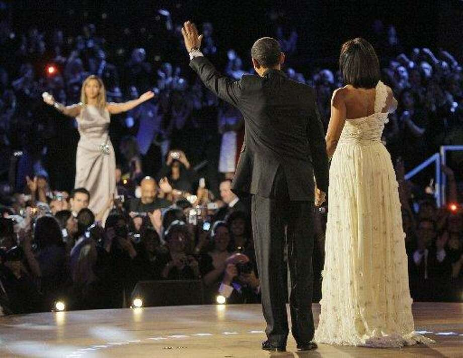 """At an inauguration ball in 2009, Beyoncé serenaded the  president and first lady with Etta James' """"At Last."""" (AP Photo/Elise Amendola)"""