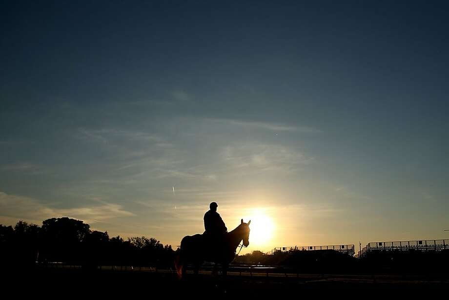 Trainer D. Wayne Lukas rides on the track during the morning workout at Pimlico Race Course on May 17, 2013 in Baltimore, Maryland.  Photo: Matthew Stockman, Getty Images