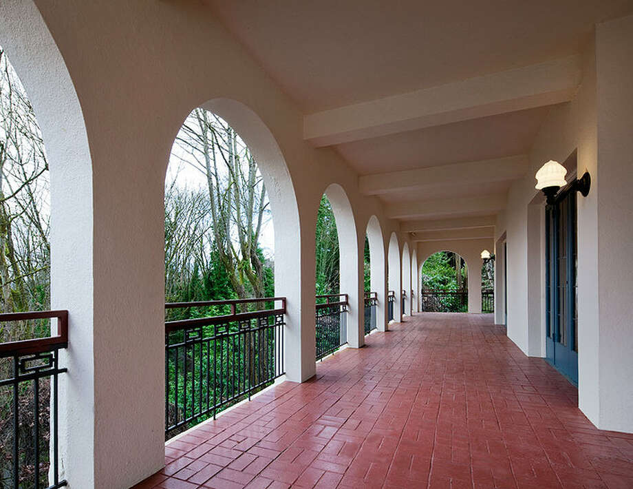 Deck of 2222 Everett Ave. E., in Capitol Hill. The 6,897-square-foot Mediterranean-style home, built in 1926, has four bedrooms, three bathrooms, two fireplaces, ornate, hand-restored ironwork and millwork, a ballroom, an office, a family room, a game room, a media room, a sun room, a play room, a two-car garage, a 1,794-square-foot unfinished sub-basement and a fountain on a 30,986-square-foot property. It's listed for $3.495 million. Photo: Chris J. Roberts, Courtesy Nicholas Glant, NWG Real Estate / (c) 2013 Chris J. Roberts Photography (206) 365-7727