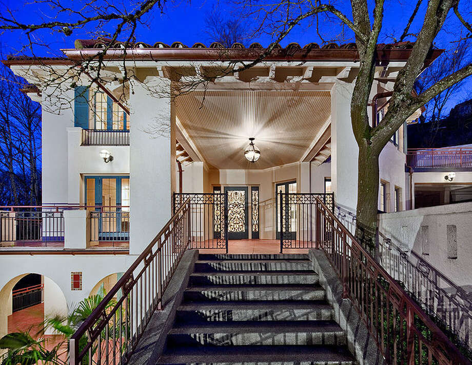 Entrance of 2222 Everett Ave. E., in Capitol Hill. The 6,897-square-foot Mediterranean-style home, built in 1926, has four bedrooms, three bathrooms, two fireplaces, ornate, hand-restored ironwork and millwork, a ballroom, an office, a family room, a game room, a media room, a sun room, a play room, a two-car garage, a 1,794-square-foot unfinished sub-basement, a fountain, decks and patios on a 30,986-square-foot property. It's listed for $3.495 million. Photo: Chris J. Roberts, Courtesy Nicholas Glant, NWG Real Estate / (c) 2013 Chris J. Roberts Photography (206) 365-7727