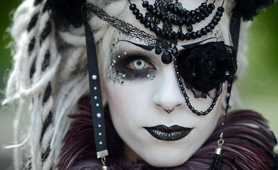 "White-eyed:A visitor to the Wave-Gothic festival poses in Leipzig, eastern Germany. Organizers expect some 20,000 visitors from all over the world for the ""dark"" music and arts festival. Highlights include an evening cemetery tour.  Photo: Hendrik Schmidt, AFP/Getty Images"