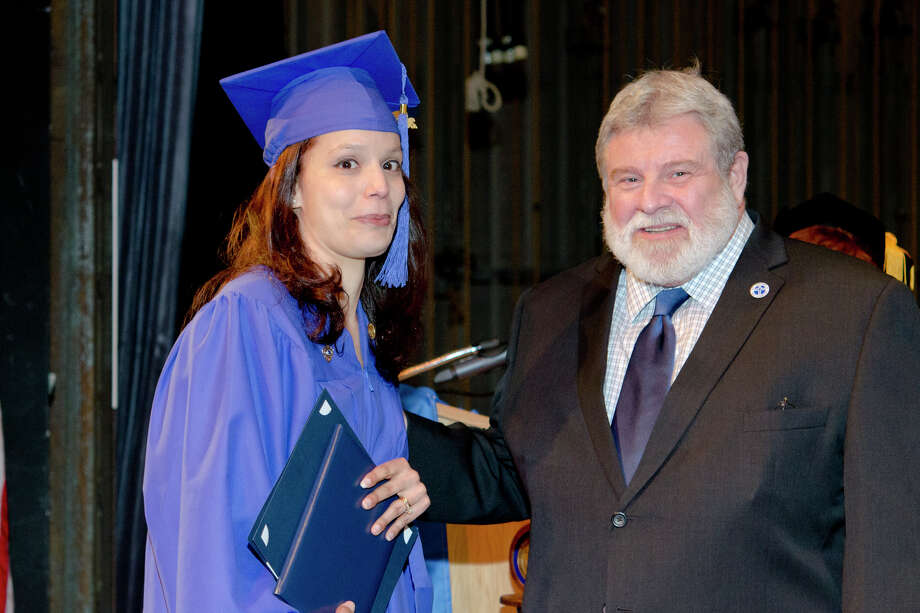 Jennifer Rodriguez, of Higganum, is presented the Francis Scifo, M.D. Award for Excellence by Dr. Francis Scifo during the twenty-first annual commencement ceremony of St. Vincent's College at the Arnold Bernhard Center at the University of Bridgeport campus on Friday, May 17, 2013. Photo: Amy Mortensen / Connecticut Post Freelance